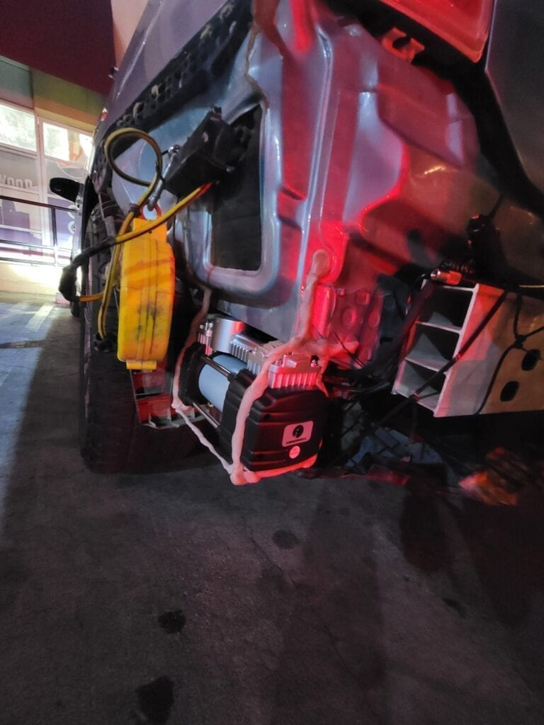 Air Compressor installed behind bumper of a Toyota Prius